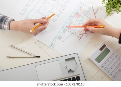 Architect working on blueprint architects workplace stock photo architects working on blueprint real estate project architect workplace architectural project blueprints malvernweather