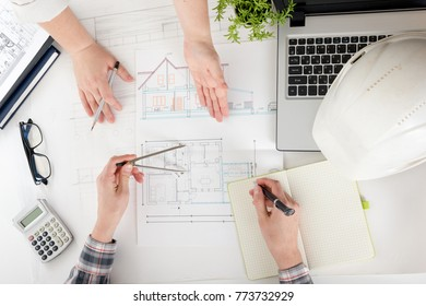 Architects working on blueprint real estate imagen de archivo stock architects working on blueprint real estate project architect workplace architectural project blueprints malvernweather