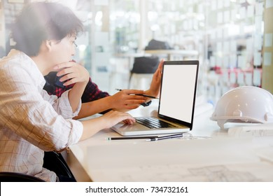 Architects working on plans design with laptop . Architect drawing on architectural project. Architectural plan