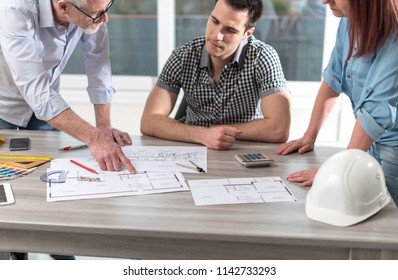 Architects working on plans at office