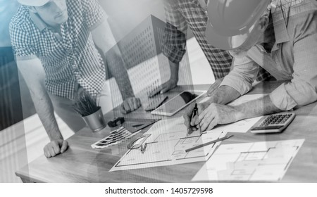 Architects working on plans at office, multiple exposure