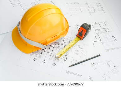 Architects workplace - architectural tools, blueprints, helmet, measuring tape, Construction concept. Engineering tools. Top view