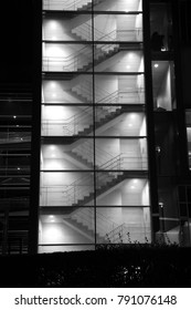 Architectural abstract structural elements with stairs, ramps and facade in monochrome at night.