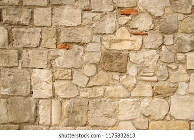 Architectural background pattern and textures of a natural stone wall bonded with mortar - York - United Kingdom