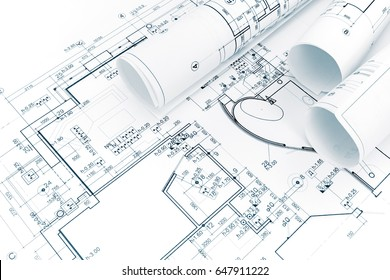 architectural background with rolls of technical drawings and blueprints