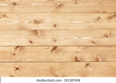 Architectural background texture of a panel of natural unpainted pine board cladding with knots and wood grain in a parallel pattern conceptual of woodwork, carpentry, joinery and construction