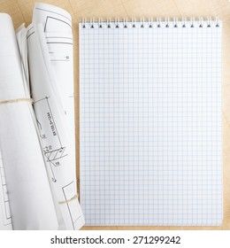 Blueprint paper blank stock photos images photography shutterstock architectural blueprint and blueprint rolls near checkered blank paper with pen on graph paper background malvernweather Choice Image