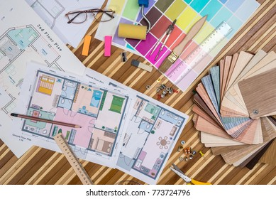 Architectural blueprint with wooden or paper samples and draw tools
