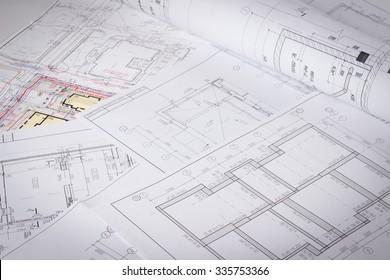 Architectural blueprints and blueprint rolls.