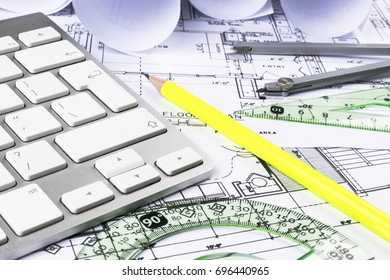 Blueprint architect money calculator symbolic photo stock photo architectural blueprints drawings of the modern house with computer keyboard architectural blueprints and blueprint rolls malvernweather Images