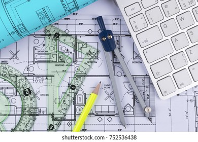 modern architecture blueprints floor plan architectural blueprints drawings of the modern house with computer keyboard and blueprint rolls blueprints drawings modern house computer stock photo