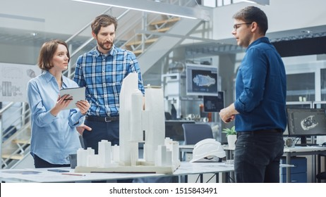 In Architectural Bureau: Team of Architects and Engineers Working on a Building Complex Prototype Project, Using City Model and Computers Running 3D CAD Software. Residential or Business District