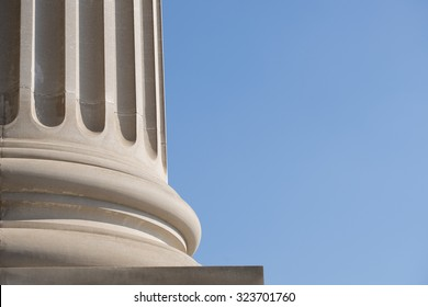 Architectural Column Against clear Blue Sky