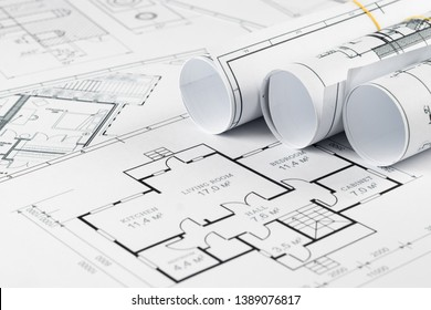 Architectural construction drawings twisted into a roll, construction projects on paper. The concept of architecture, construction, engineering. Copy space.
