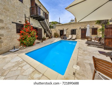 Architectural detail of authentic Holiday apartment with swimming pool and flowers on a sunny day