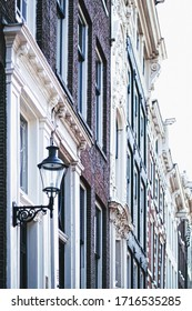 Architectural detail of a building on the main city center street of Amsterdam in Netherlands, european architecture