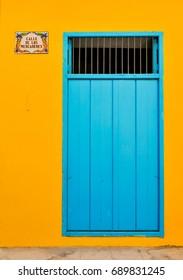 Architectural detail of colorful door on Calle de Mercaderes (Marchants Street) in Havana, Cuba