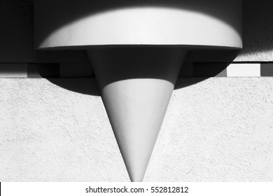 An architectural detail. It consists of the cylindrical and the conical parts. Bright sunshine makes an interesting elliptical shape of lights and shadows over this object. Russia, Moscow, June 2013.