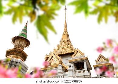 Architectural detail from exterior view of the Buddhist temple, Wat Traimit over sky in Bangkok, Thailand