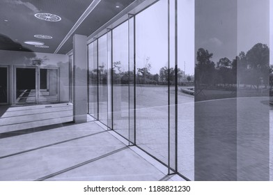 Architectural detail with glass, reflections, sunlight and shadows