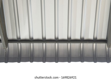 Architectural detail of metal roofing on commercial construction of modern building complex