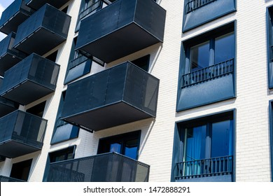 Architectural detail of a modern apartament building. Black and white facades of modern residential buildings.