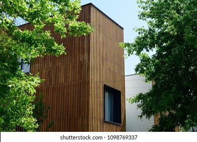 Architectural detail of vertical natural wood cladding house