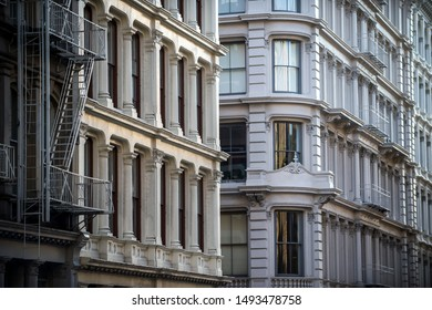 Architectural detail view of traditional cast iron buildings in the Soho Cast Iron Historic District in downtown Manhattan, New York City