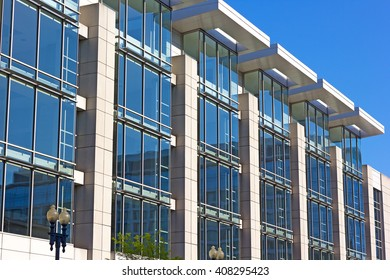Architectural details of convention center building in Washington DC. Building windows illuminated by the light coming through roof openings.