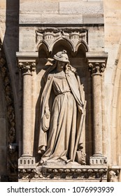 Architectural details of the facade of catholic cathedral Notre-Dame de Paris. Notre-Dame cathedrall is built in French Gothic architecture. Paris, France