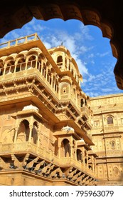 The architectural details of Jaisalmer fort palace (viewed through an arcade) in Jaisalmer, Rajasthan, India