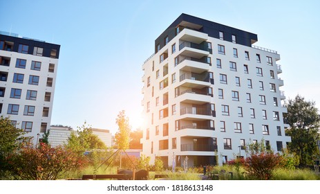 Architectural details of modern apartment building. Modern european residential apartment building complex. Sunset.