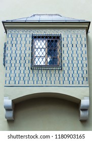 Architectural details with a window in bars in Warsaw old town (Poland).