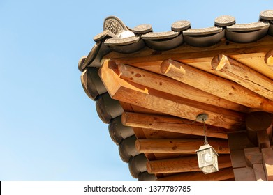 Architectural details of wooden eaves and ceramic tile roof ends of a tradition house at Korean ancient village in Jeonju, South Korea