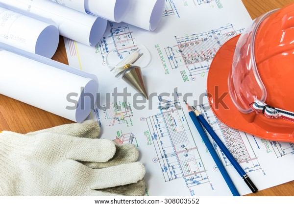 Architectural drawings paper with equipment on the table