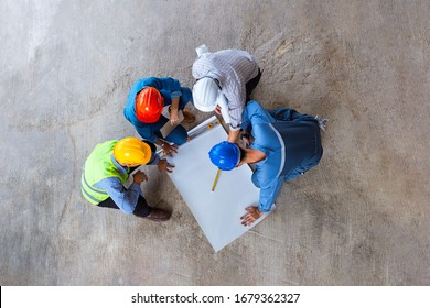 Architectural engineer working on his blueprints with documents on construction site. meeting, discussing,designing, planing
