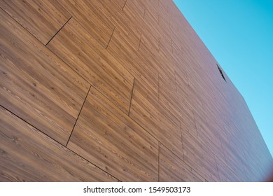 Architectural facade covered with wooden pattern HPL boards