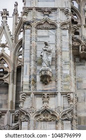 Architectural fragment of Milan Cathedral (Duomo di Milano, 1386), dedicated to St Mary of the Nativity (Santa Maria Nascente), with Gothic and Lombard Romanesque style. Milan, Italy.