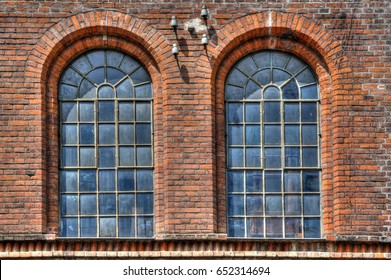 Architectural highlights. Window in the front of an old industrial building.
