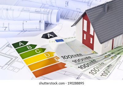 Architectural model, architectural plans, energy efficiency labels and money.