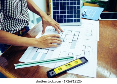 Architectural offiice site desk Solar cell background construction project ideas concept.Renewable energy
