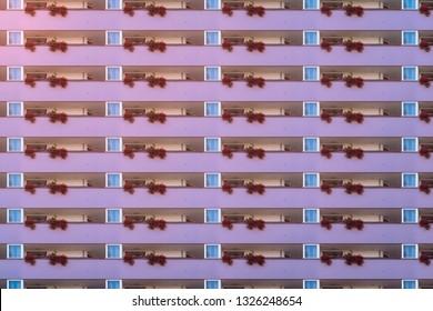 architectural pattern, purple balcony facade with geranium