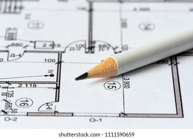 The architectural plan of the house is printed on a white sheet of paper. A white pencil on it. June 2018, Russia, Moscow