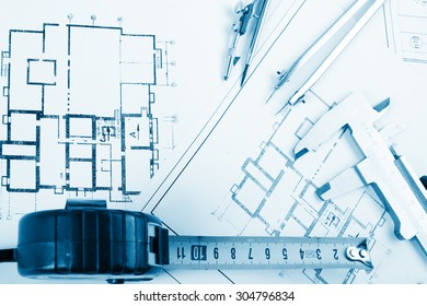 Workplace architect architectural project blueprints blueprint foto architectural project blueprints blueprint rolls on plans engineering tools view from the top malvernweather Choice Image