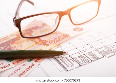 Architectural project and Russian money with glasses. Construction background.