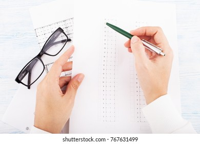 Architectural project, women's hands and glasses. Construction background.