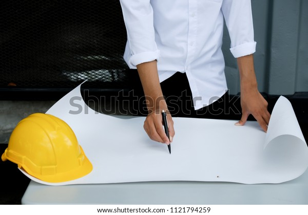 Architectural work site desk background construction project ideas concept, With drawing equipmen