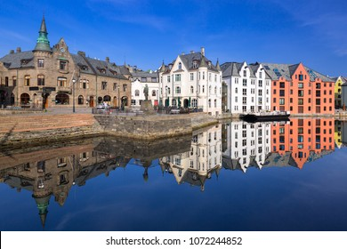 Architecture of Alesund town reflected in the water, Norway