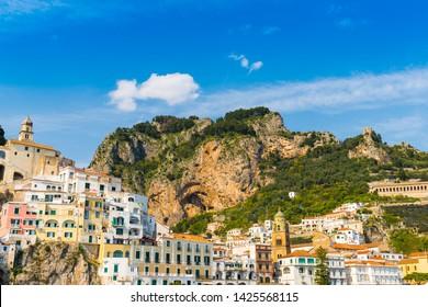 Architecture of Amalfi at sunny day. Italian seaside town on coastline of Tyrrhenian Sea. Summer in Italy