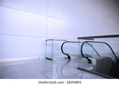 Architecture background. Escalator and wall in some modern building.